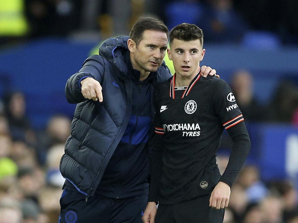Chelsea manager Frank Lampard, left, speaks to player Mason Mount on the touchline , during the English Premier League soccer match between Everton and Liverpool at Goodison Park, in Liverpool, England, Saturday, Dec. 7, 2019. (Nigel French/PA via AP)