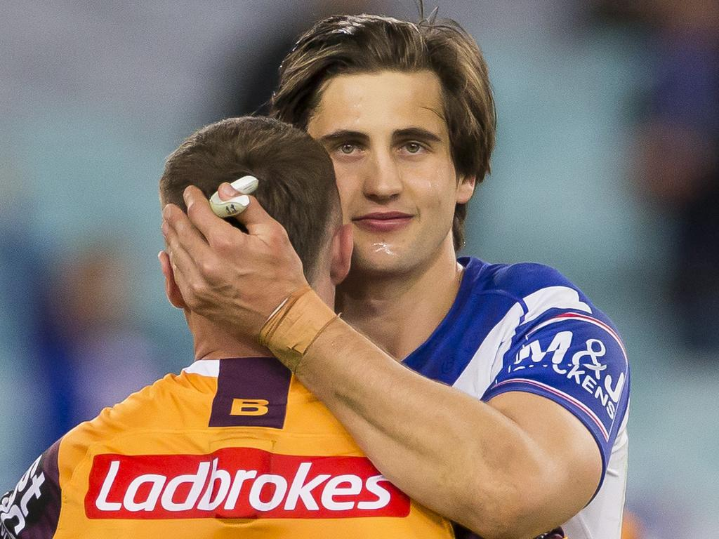 Lachlan Lewis of the Bulldogs hugs Jake Turpin of the Broncos after the Round 25 NRL match between the Canterbury Bulldogs and the Brisbane Broncos at ANZ Stadium in Sydney, Saturday, September 7, 2019. (AAP Image/Craig Golding) NO ARCHIVING, EDITORIAL USE ONLY