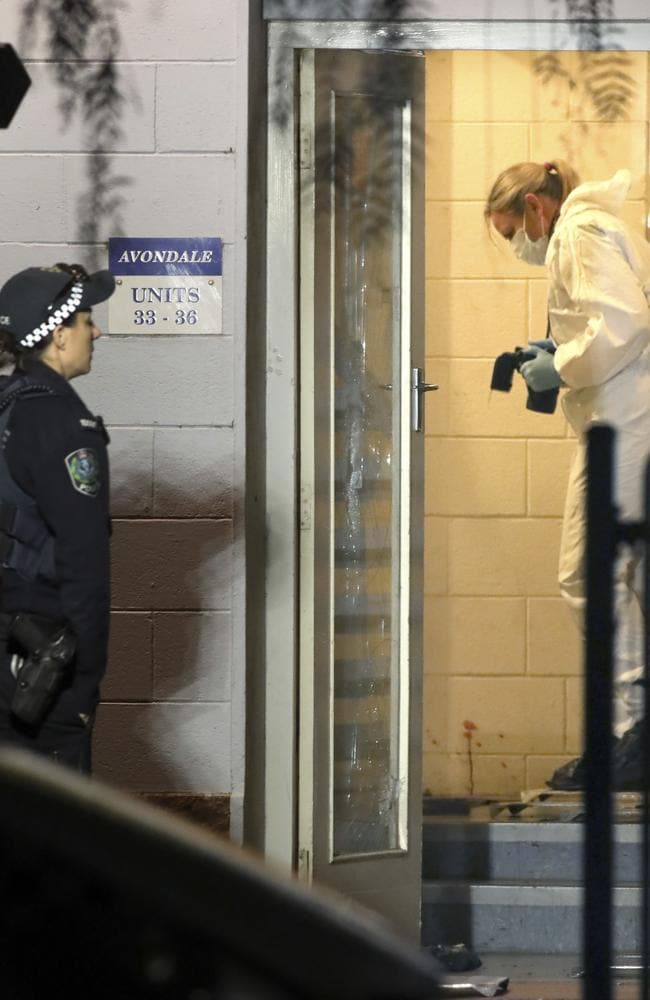 Police forensic officers examine the scene in a group of flats in Elizabeth. Picture: Dean Martin