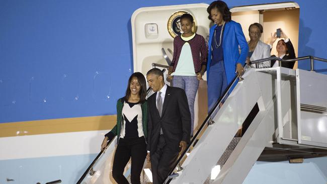 US President Barack Obama, First Lady Michelle Obama and their daughters walk off Air Force One during an arrival ceremony at Waterkloof Air Base in Centurion, near Pretoria on Friday. Picture: AFP