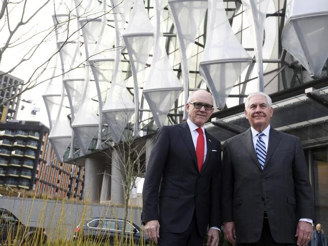 US Secretary of State Rex Tillerson, right, and Woody Johnson, US ambassador to Britain stand outside the new US embassy in London. Picture: Toby Melville/AP
