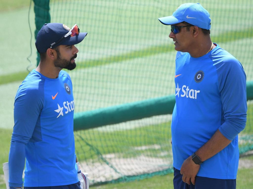 (FILES) This file photo taken on March 24, 2017 shows India's cricket coach Anil Kumble (R) talking with captain Virat Kohli during a training session on the eve of a Test match between India and Australia at the Himachal Pradesh Cricket Association Stadium in Dharamsala. Signs of a rift between India's skipper Virat Kohli and coach Anil Kumble have shaken the country ahead of the team's campaign to win a second straight Champions Trophy. ----IMAGE RESTRICTED TO EDITORIAL USE - STRICTLY NO COMMERCIAL USE----- / GETTYOUT----  / AFP PHOTO / PRAKASH SINGH / ----IMAGE RESTRICTED TO EDITORIAL USE - STRICTLY NO COMMERCIAL USE----- / GETTYOUT