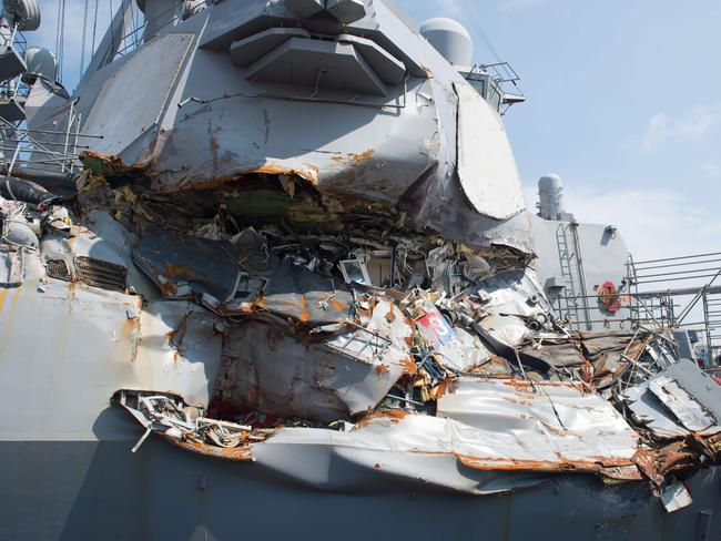 The crushed side of the USS Fitzgerald's superstructure — including the remains of the captain's cabin. Picture: USN