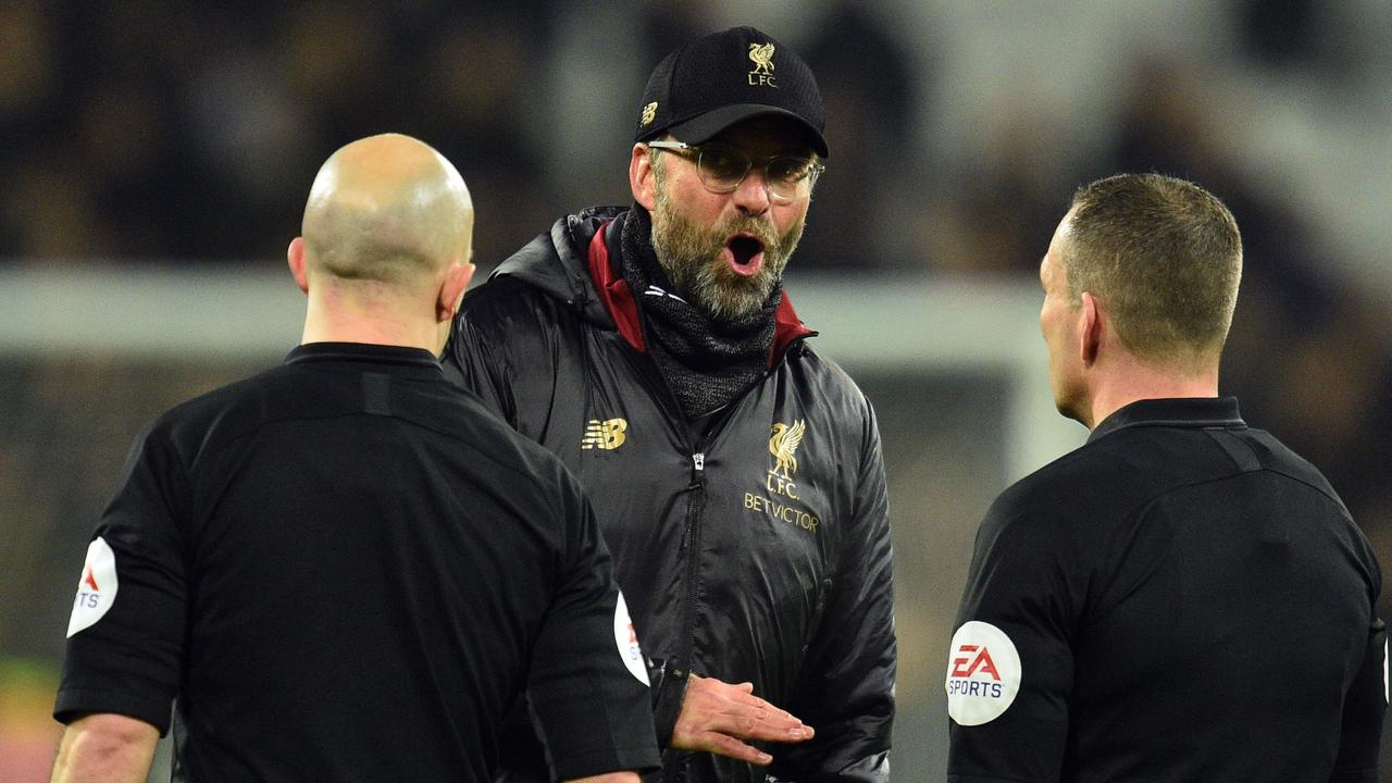 Liverpool coach Jurgen Klopp arguing with referees following a controversial draw in the Premier League on February 4.