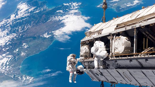 A view of Earth as astronauts perform a spacewalk at the International Space Station.