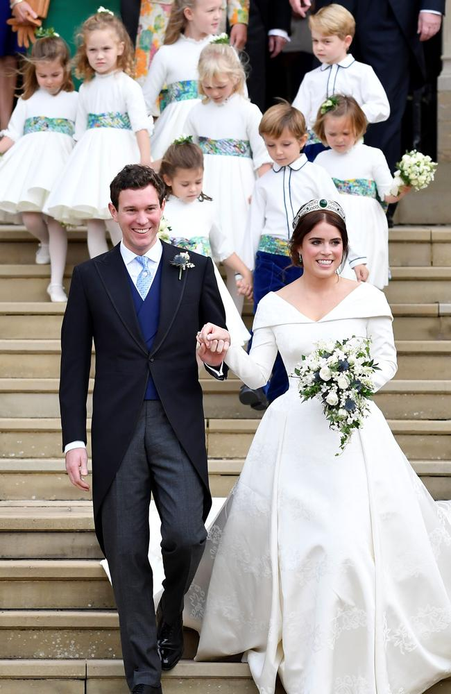 Princess Eugenie and Jack Brooksbank leave the chapel. Picture: TOBY MELVILLE / POOL / AFP)