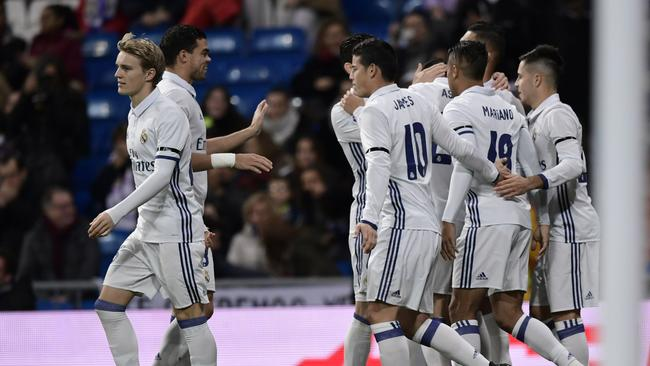 Real Madrid players celebrate.