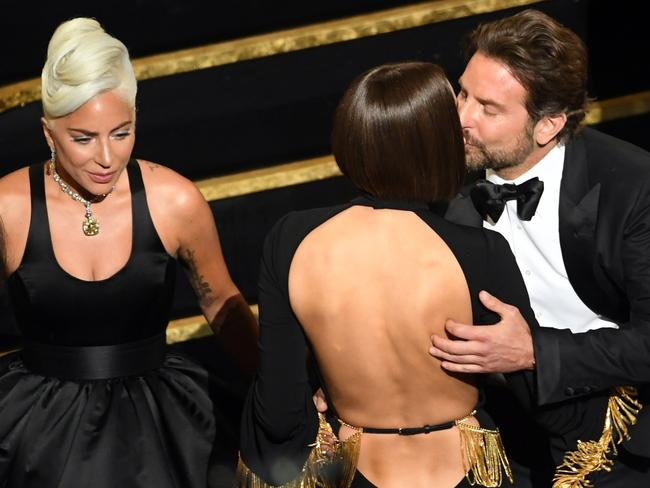 (L-R) Lady Gaga, Irina Shayk and Bradley Cooper at the Oscars. Picture: Getty