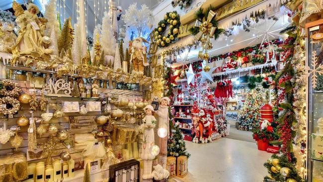 The vast store's rooms are filled with glittering decorations and gifts.
