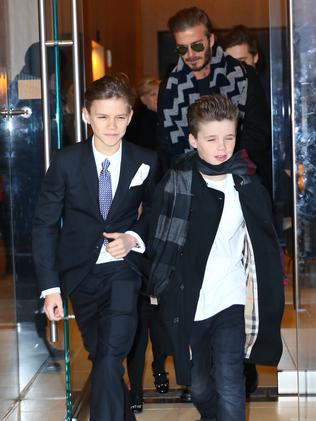 David Beckham and children Romeo and Cruz leave their hotel in New York City, on their way to designer mother Victoria Beckham's fashion show.