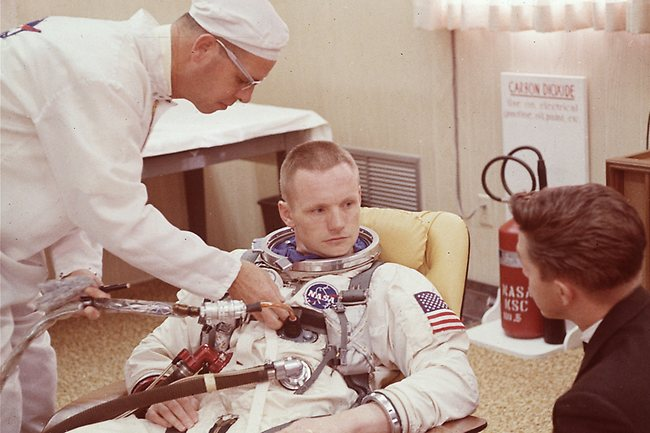 Neil Armstrong is seated during a suiting up exercise Cape Kennedy, Fla., in preparation for the Gemini 8 flight in 1966. (AP Photo/File)