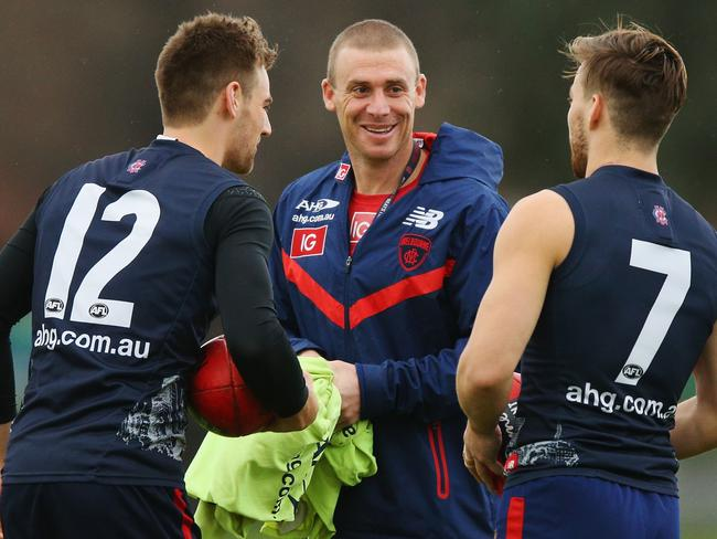 Coach-in-waiting Simon Goodwin talks with Dom Tyson (L) and Jack Viney at training. (Photo by Michael Dodge/Getty Images)