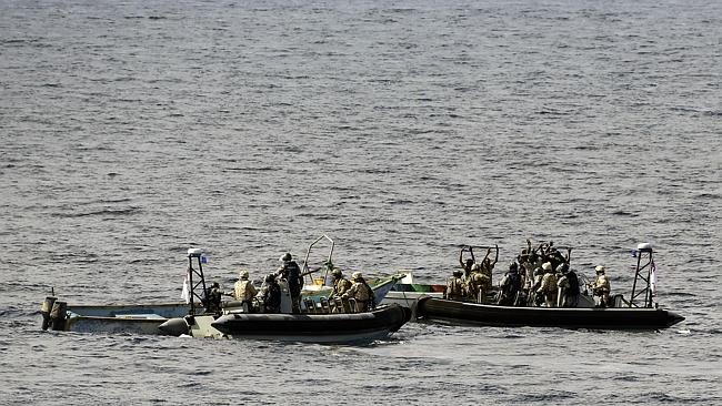 An Australian Navy boarding party from HMAS Melbourne stop a boat of suspected Somali Pirates of the coast of Somalia. Picture: Defence