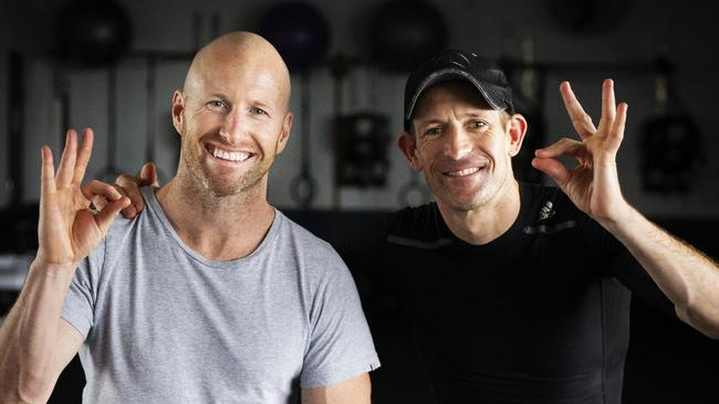 She's apples: Fitness trainer Trent Langlands and Hugh Bowman take a break. Picture: Jenny Evans