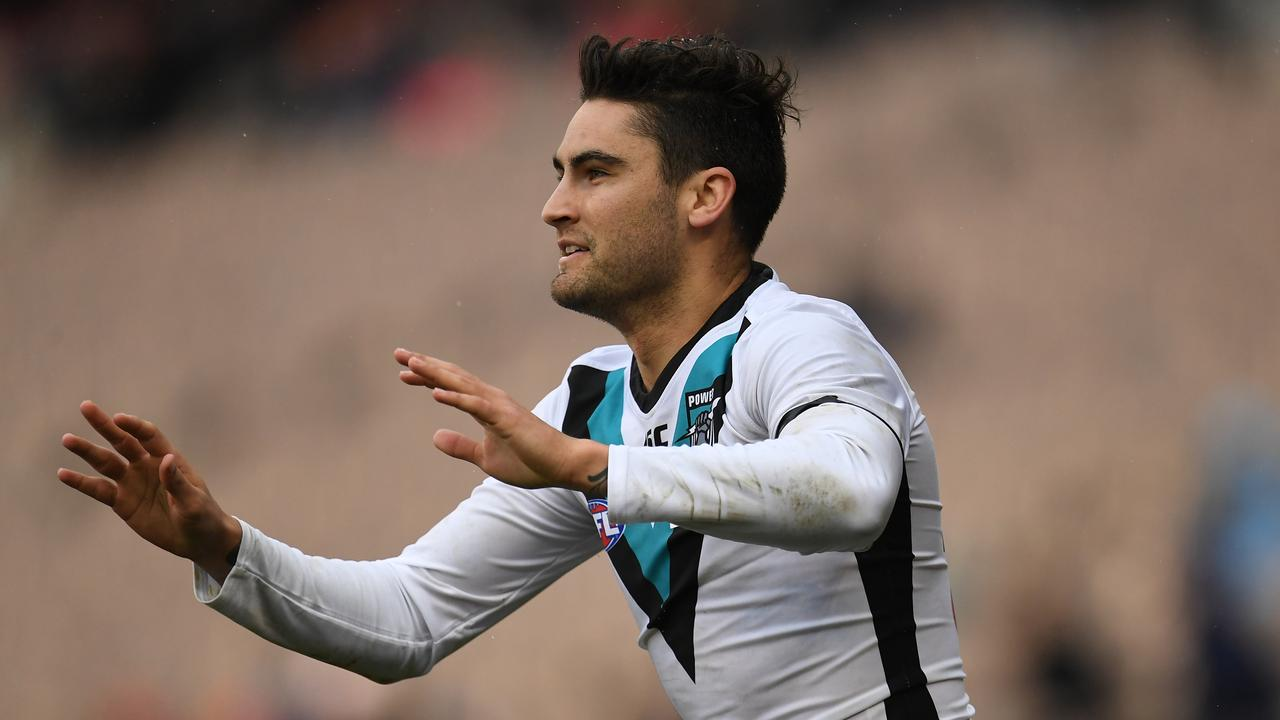 Chad Wingard celebrates a goal against Carlton this season.
