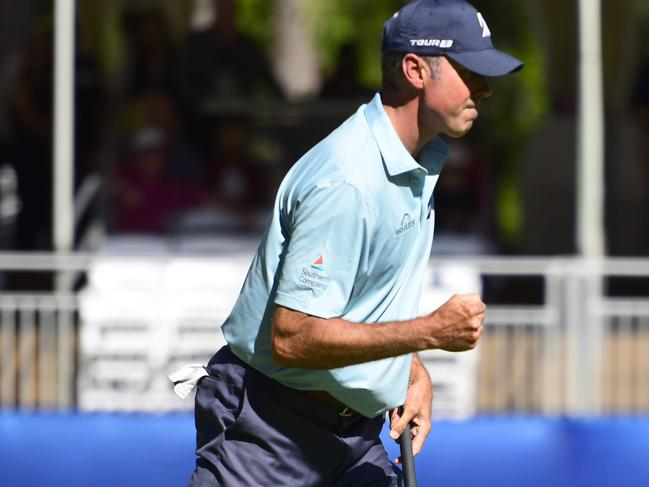 Matt Kuchar reacts after sinking his birdie putt on the 15th green.