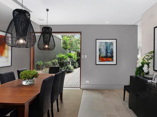 The dining room opens to low-maintenance outdoors.