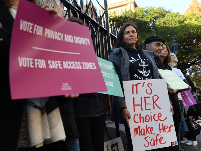 Demonstrators in favour of safe buffer-zones around NSW abortion clinics stand outside the NSW State Parliament building in Sydney on Thursday. Photo: AAP/David Moir