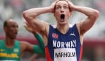 TOKYO, JAPAN - AUGUST 03: Karsten Warholm of Team Norway reacts after winning the gold medal in the Men's 400m Hurdles Final on day eleven of the Tokyo 2020 Olympic Games at Olympic Stadium on August 03, 2021 in Tokyo, Japan. (Photo by Michael Steele/Getty Images)