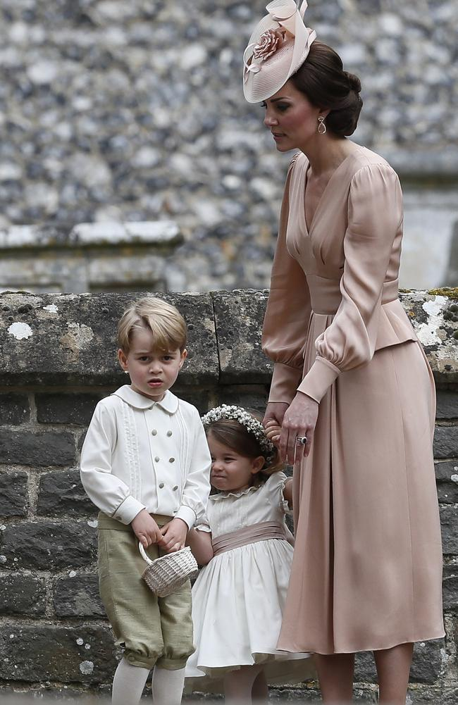 Catherine, Duchess of Cambridge, right, stands with Princess Charlotte and Prince George, who were flower boys and girls at the wedding of Pippa Middleton and James Matthews. Picture: Getty