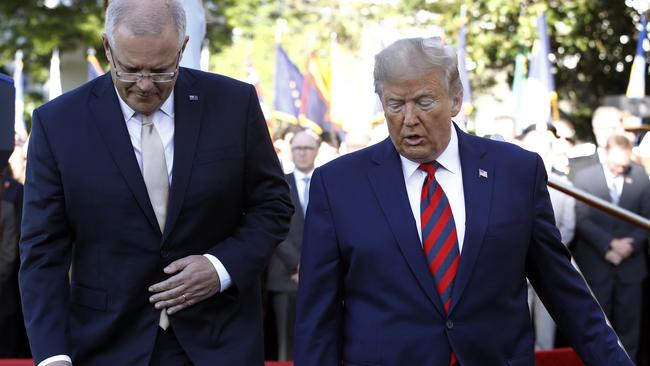 Australian Prime Minister Scott Morrison and US President Donald Trump walk during a State Arrival Ceremony on the South Lawn of the White House in Washington, Friday, Sept. 20, 2019, in Washington. Picture: AP /Patrick Semansky.