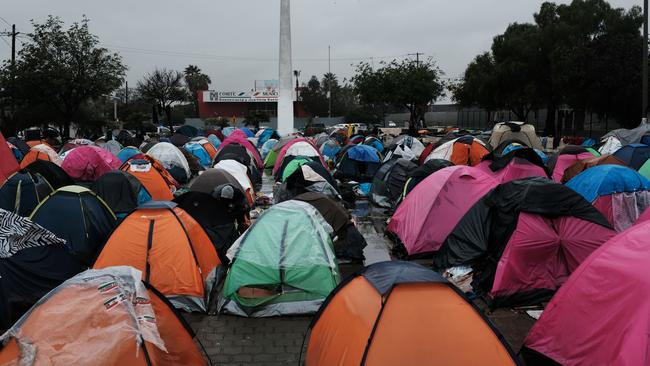 Tents belonging to a group of Mexicans numbering over 500, who have been deported recently from America, stand in a tent camp on a rainy afternoon on January 14, 2019 in Tijuana, Mexico. Like members of the migrant caravan, the deportees, many of whom have lives and families back in the United States, are waiting to try to cross back into America. Picture: Spencer Platt