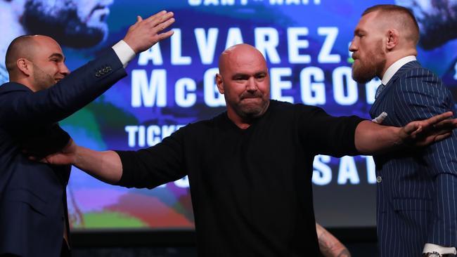 Conor McGregor and Eddie Alvarez face-off as UFC president Dana White breaks them up.