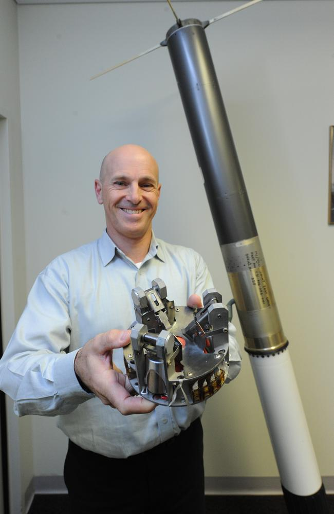 Peter Steiner, production manager for weapons systems at BAE, with a Nulka ship missile and its guidance controller.