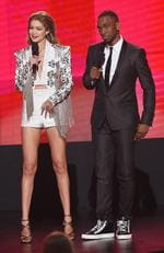 Co-hosts Gigi Hadid and Jay Pharoah speak onstage during the 2016 American Music Awards at Microsoft Theater on November 20, 2016 in Los Angeles, California. Picture; Getty