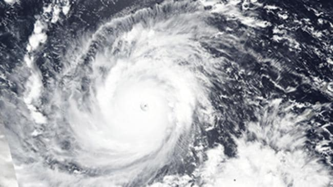A NASA image captured on Wednesday shows Mangkhut churning towards the Philippines. Picture: Lauren Dauphin/NASA Earth Observatory/AP