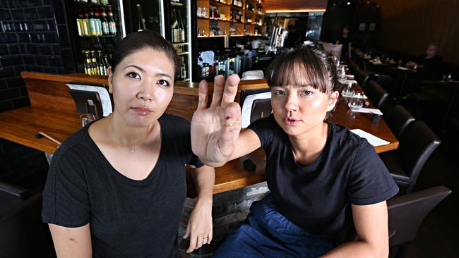 Emi Rakowski and Marie Yokoyama with the shard at the Birds Nest restaurant who were victims of the glass in the meal scam.