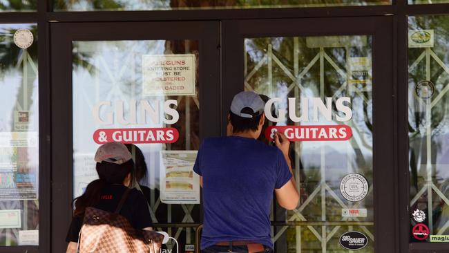 People peer into Guns & Guitars store in Mesquite, Nevada. Picture: AFP/Robyn Beck