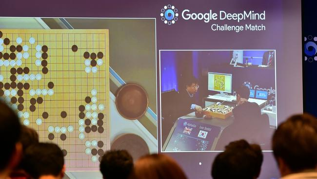 Spectators watch a big screen showing live footage of the third game of the Google DeepMind Challenge Match between Lee Se-Dol, one of the greatest modern players of the ancient board game Go, and the Google-developed supercomputer. Picture: Jung Yeon-Je