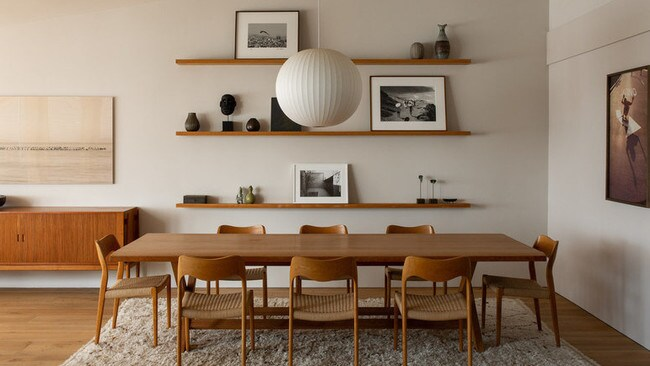A dining room with wood shelving. Picture: Mansion Global