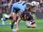 Jake Trbojevic of the Blues tackles Gavin Cooper of the Maroons during Game 3 of the 2018 State of Origin series between the NSW Blues and the Queensland Maroons at Suncorp Stadium in Brisbane, Wednesday, July 11, 2018. (AAP Image/Dave Hunt)