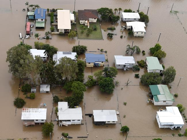 Houses are inundated with flood waters in Ingham in North Queensland. (AAP Image/Dan Peled)