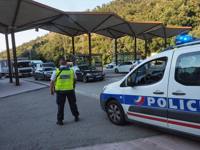 French police officers control vehicles coming across the border from Spain near Le Perthus, southern France following two quick-succession, separate attacks in Barcelona and Cambrils. Picture: AFP