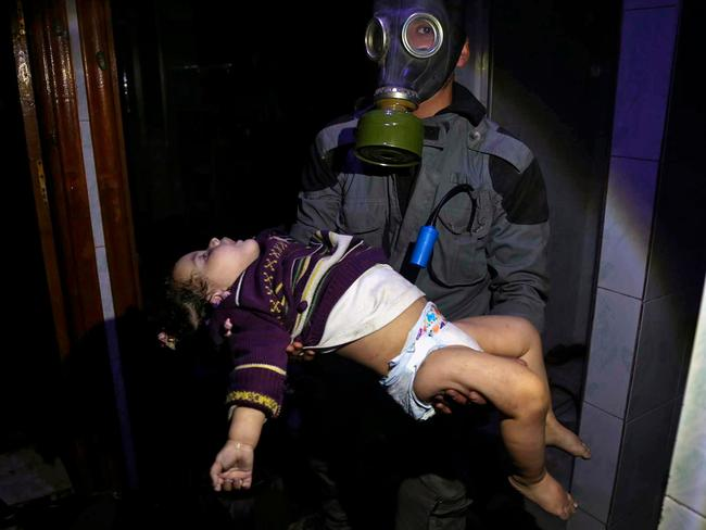An image from the Syrian Civil Defense White Helmets showing a rescue worker carrying a child caught up in an alleged chemical weapons attack. Picture: Syrian Civil Defense White Helmets via AP, File.