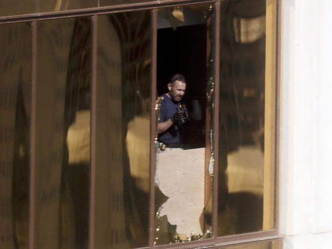 An investigator works in room 32135. Picture: AP/Gregory Bull