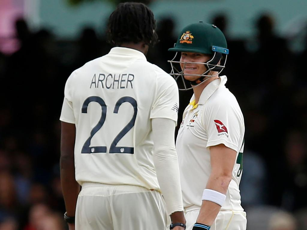 Australia's Steve Smith (R) smiles at England's Jofra Archer during play on the fourth day of the second Ashes cricket Test match between England and Australia at Lord's Cricket Ground in London on August 17, 2019. (Photo by Ian KINGTON / AFP) / RESTRICTED TO EDITORIAL USE. NO ASSOCIATION WITH DIRECT COMPETITOR OF SPONSOR, PARTNER, OR SUPPLIER OF THE ECB