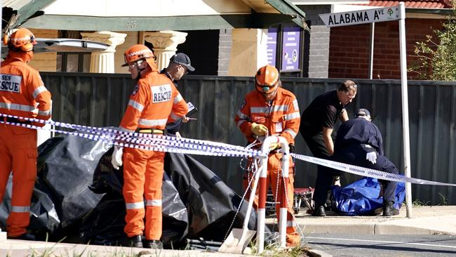The body is removed from the scene. Picture: Mike Burton/AAP