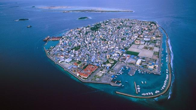 Shrinking Island: One of Earth's most vulnerable nations to climate change, the Maldives Islands are severely threatened by rising sea levels. Pic: Peter Essick.