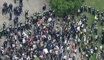 Police form a ring around protesters in Melbourne.