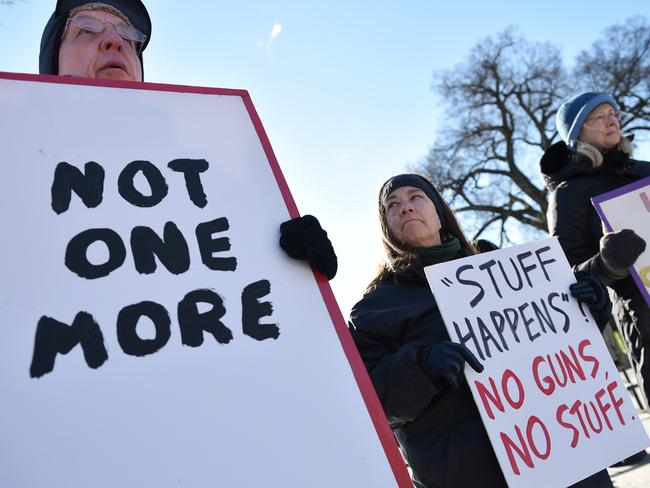 """Demonstrators take part in a rally to demand """"sensible"""" gun laws in front of the White House on January 4, 2016 in Washington. Photo: AFP/mandel ngan."""