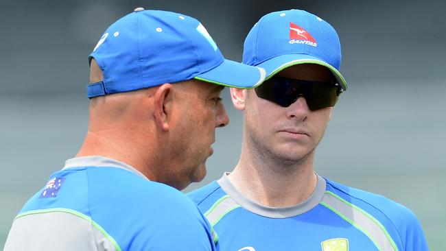 Australia's captain Steven Smith (R) speaks with coach Darren Lehmann.