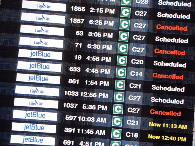 Cancelled ... the flight board at Logan International Airport in Boston. Picture: AFP