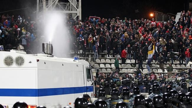 Riot police use a water cannon to stop the fight between fans. Picture: AP Photo/Alexander Mysyakin