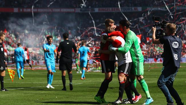 Captain, Dirk Kuyt of Feyenoord Rotterdam celebrates with team mates Brad Jones