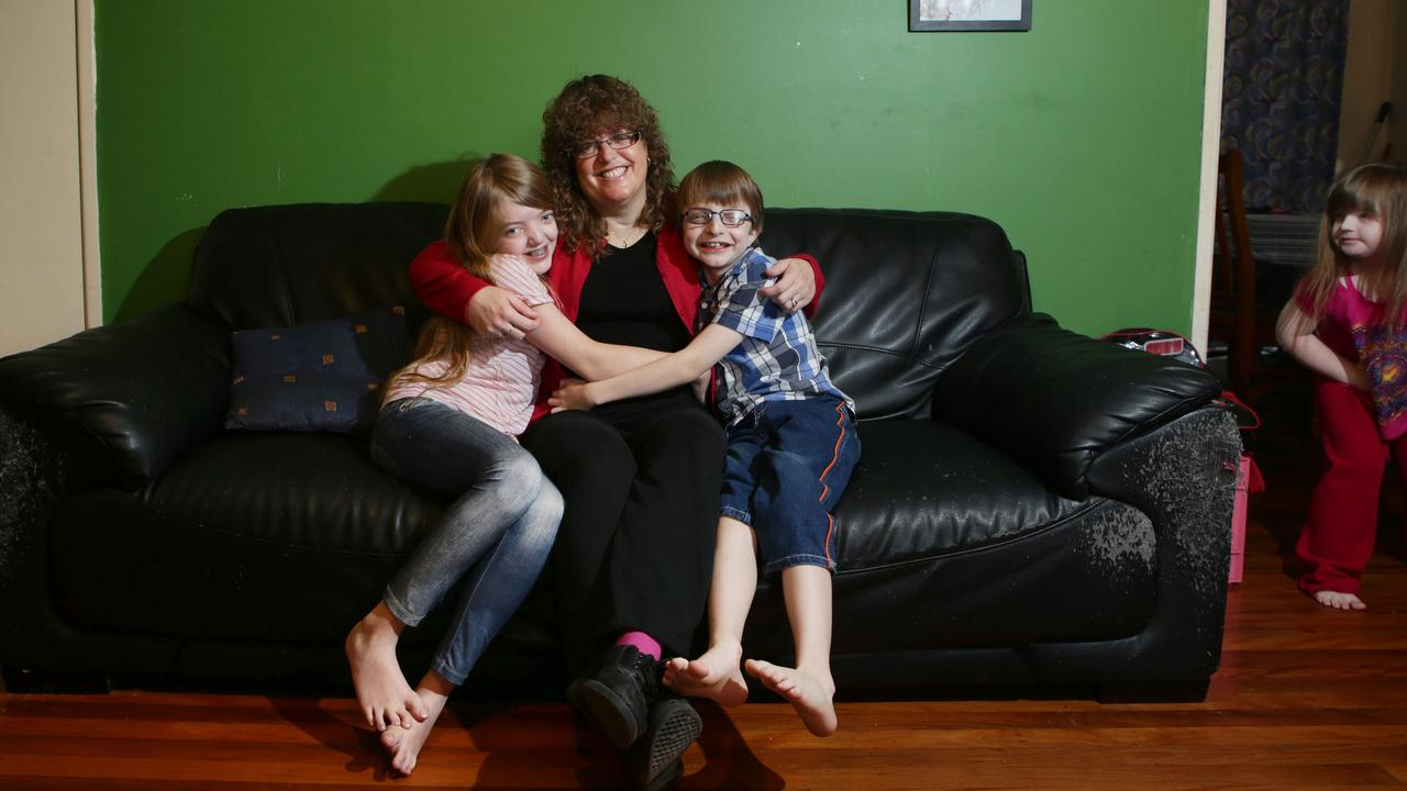 Jenny Woolsey with her children Melissa, when she was 12, and Nick, when he was 9, who have Crouzon syndrome. Jessica, who has Down syndrome, is at the side of the photo.