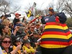 Tigers and Crows fans in the crowd show their support during the 2017 AFL Grand Final Parade on Friday. Picture: Scott Barbour/Getty Images